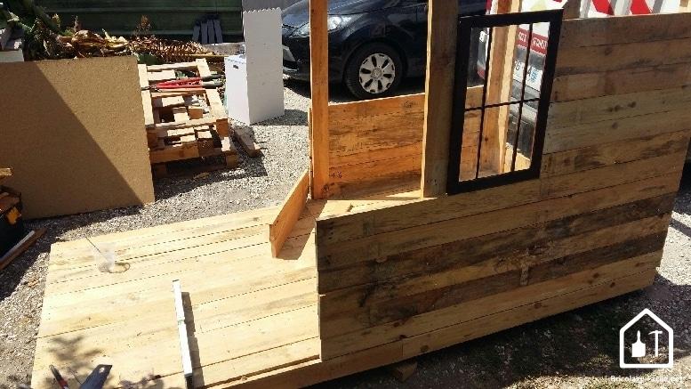 Hacer una caseta de paletas de madera-una pared